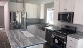 Kitchen with Stainless Farm Sink & Appliances