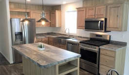Kitchen Island Stainless Appliances and Farm Sink